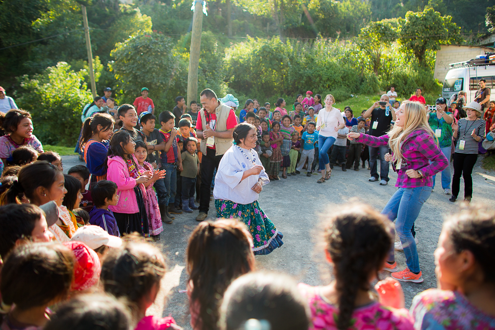 Team member Nancy Dice dances with villagers!