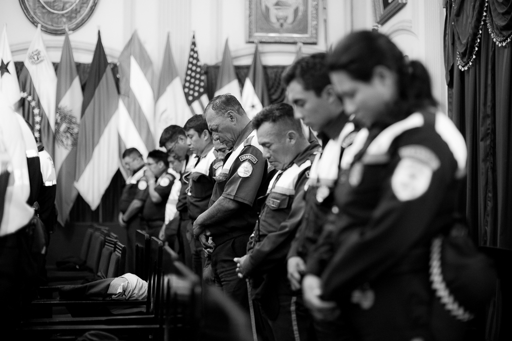 Group of police officers praying