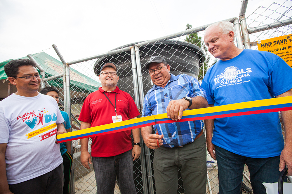 "The local Pastor who will manage and watch over the well for the community, cut the ribbon with MSI Board members Pastor Ruben Guajardo (left) and Howard ""Butch"" Wilson (right)."