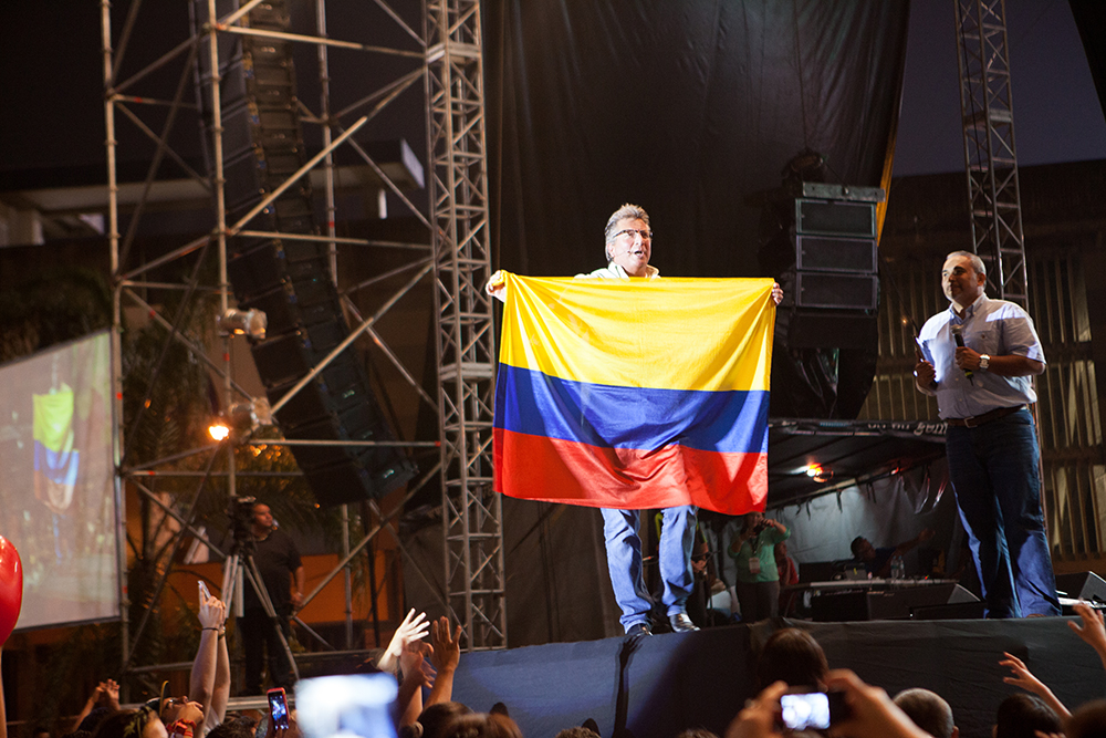 Mike Carrying the Colombian Flag at Festival